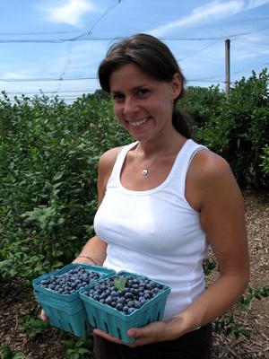 Jenn with quarts of berries