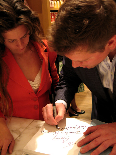 Tyler signs Jen's book